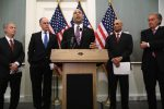 Clifton Broumand participates in a news conference with US Senators.